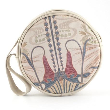 Round handbag made of elegant art nouveau fabric, combined with cream-coloured leather