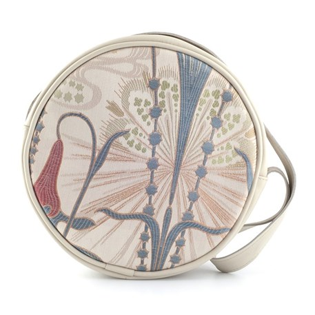 Round handbag made of elegant art nouveau fabric, combined with cream-coloured leather.